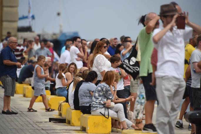 People gathered at the Valletta waterfront to follow the day's races