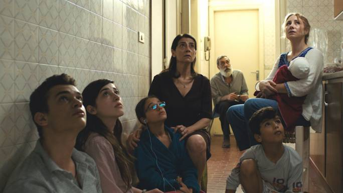 Family under siege: Hiam Abbass (centre) gives a towering performance as the steely matriarch of Insyriated