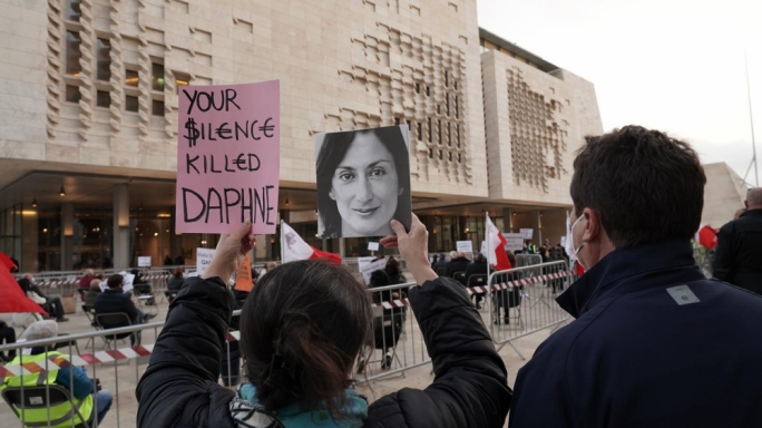 Justice for Daphne Caruana Galizia: anti-corruption activists protest outside the Maltese parliament