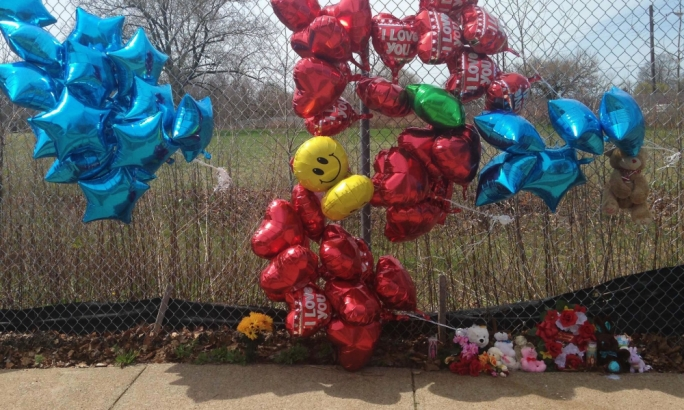 A makeshift memorial along a fence where Robert Godwin was killed