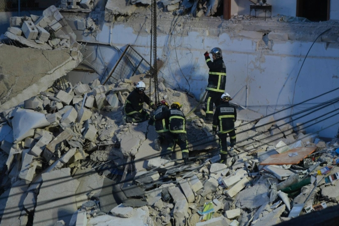 Rescuers had to work carefully given the instability of the rubble