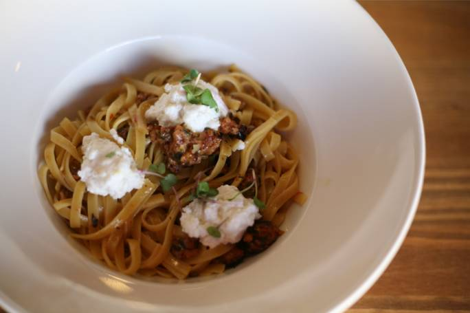 Taglialoni with sausage, harissa and lemon ricotta