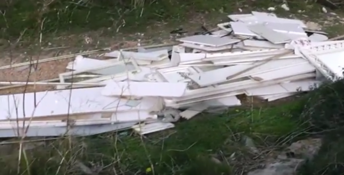 A screenshot from the video shows the remains of a bedroom dumped at Selmun
