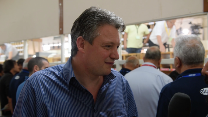 Konrad Mizzi speaks to the press after Labour's landslide victory