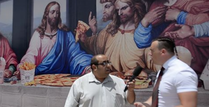 Police inspector Sandro Camilleri (right) speaks to L-Orizzont about the 'Last Supper' billboard. Photo: Inews