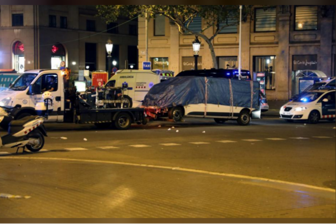 The suspected van is towed away from the area where it crashed into pedestrians at Las Ramblas in Barcelona, Spain