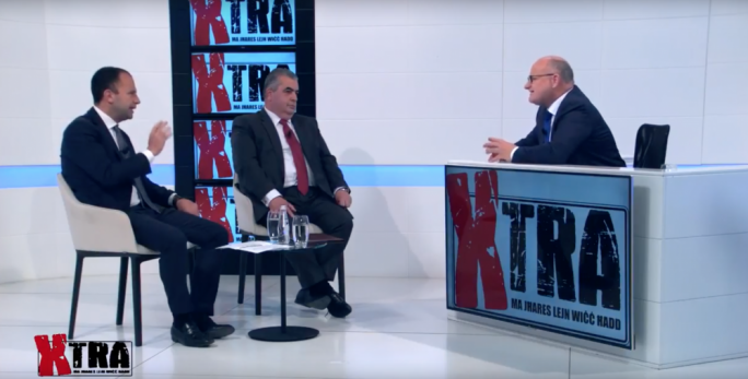 Social solidarity minister Michael Falzon and shadow minister Claudio Grech discussing the pensions issue on Xtra