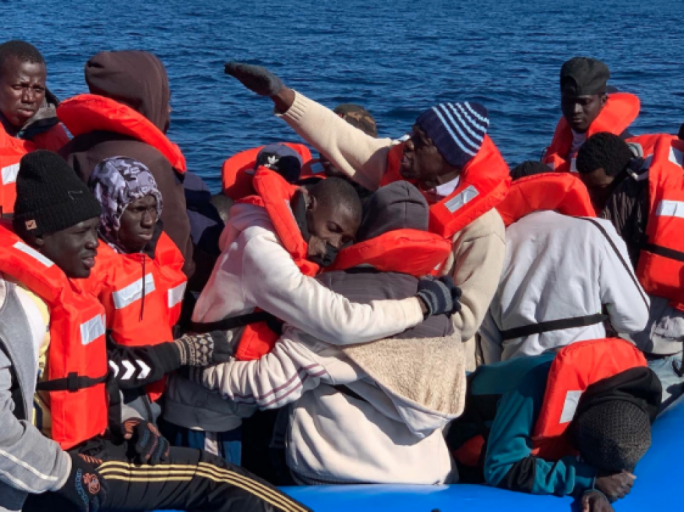 Asylum seekers were rescued off a rubber boat in distress