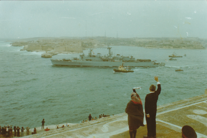 Wave goodbye: 1979, the last British warship sails out of the Grand Harbour, as President Anton Buttigieg and his wife bid the British forces farewell