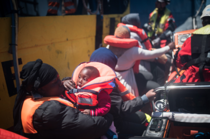 A mother and child arrive at the Sea-Watch 3 inside one of the ship's two fast rescue boats (Photo: Nick Jaussi/Sea-Watch)
