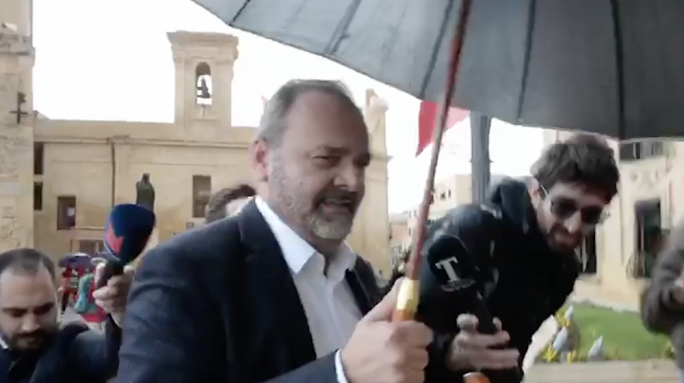 Chris Cardona gave no comments to journalists as he walked up the stairs of Castille