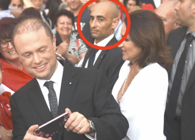 Kenneth Camilleri, who formed part of the Prime Minister's security detail, is understood to have passed on a message to Melvin Theuma about a promise of bail and money for three men accused of murdering Daphne Caruana Galizia. Camilleri is seen here accompanying the PM during an activity in the 2017 general election campaign.