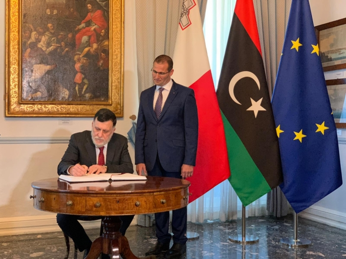 Libyan GNA leader Fayez el Serraj signing the visitors' book at Auberge de Castille before talks with Prime Minister Robert Abela (Photo: Karl Azzopardi/MaltaToday)