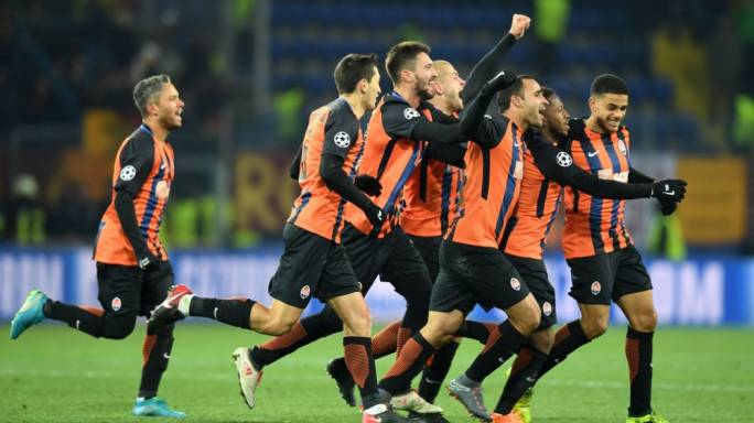 Shakhtar Donetsk's players celebrating after scoring the winning goal