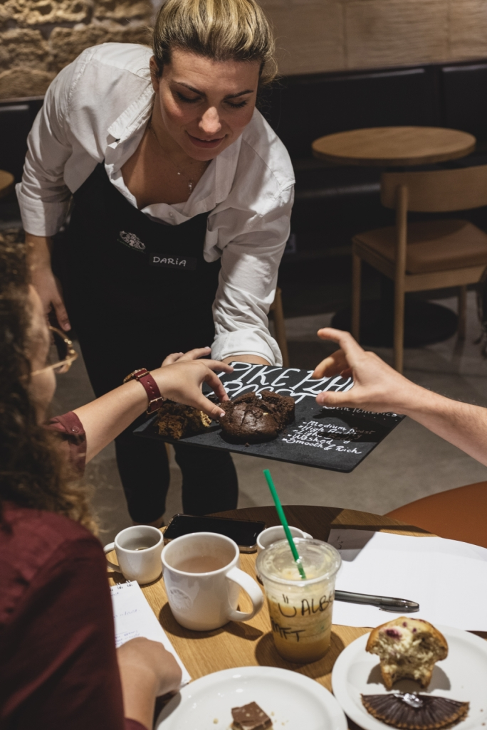 Starbucks barista Daria shares serving some fantastic treats. Photo: Zak Farrugia/Mediatoday