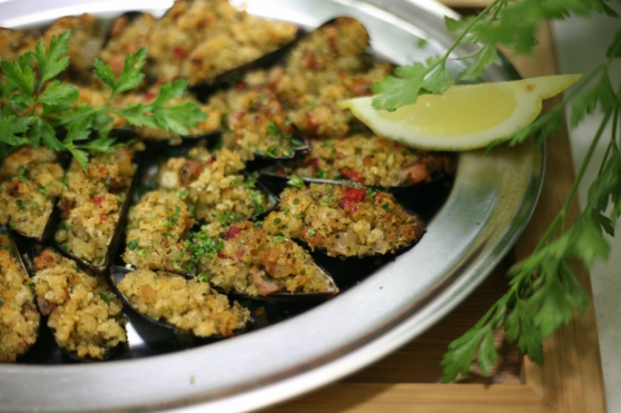 Stuffed mussels with guanciale and breadcrumbs