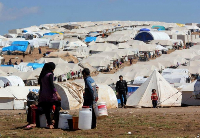 Refugees at the Atmeh refugee camp, in the northern Syrian province of Idlib