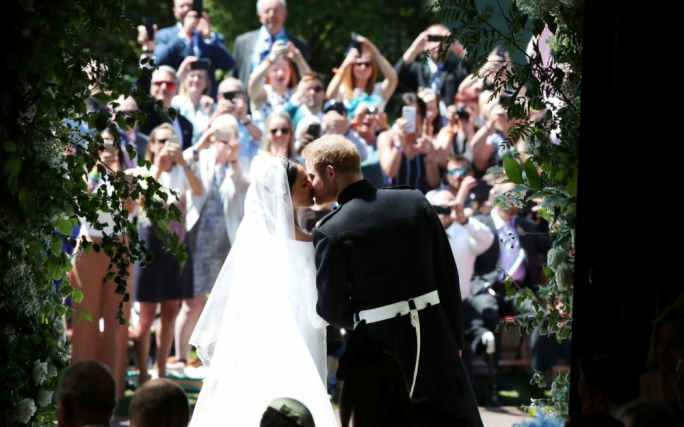 Millions tune in as Prince Harry and Meghan Markle tie the knot