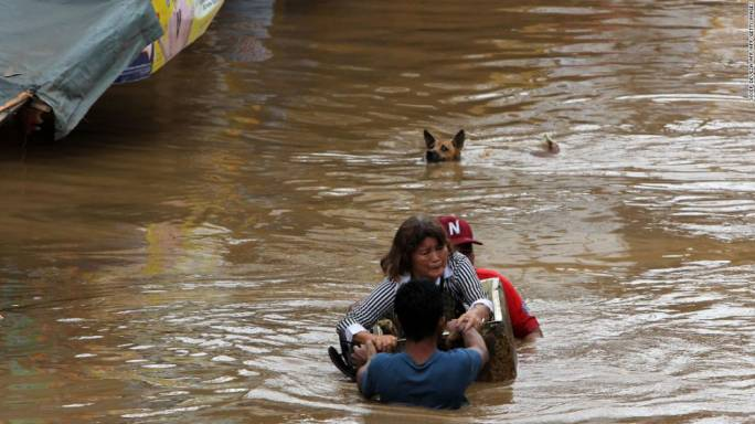 Storm Tembin has hit the Philippines, bringing flash flooding and mudslides and killing more than 100 people