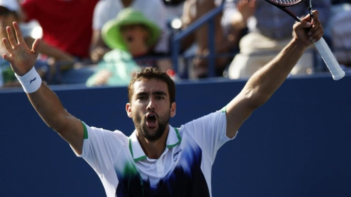 Marin Cilic of Croatia celebrates his win over Tomas Berdych of the Czech Republic during their quarter--final match at the 2014 U.S. Open tennis tournament in New York, September 4, 2014