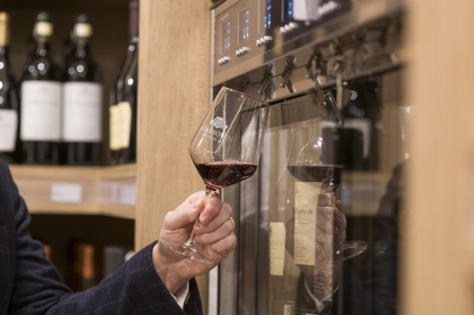 A special dispensing machine allows customers to taste premium wines before buying them