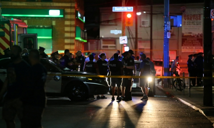 One woman dead, 13 injured in Toronto shootout