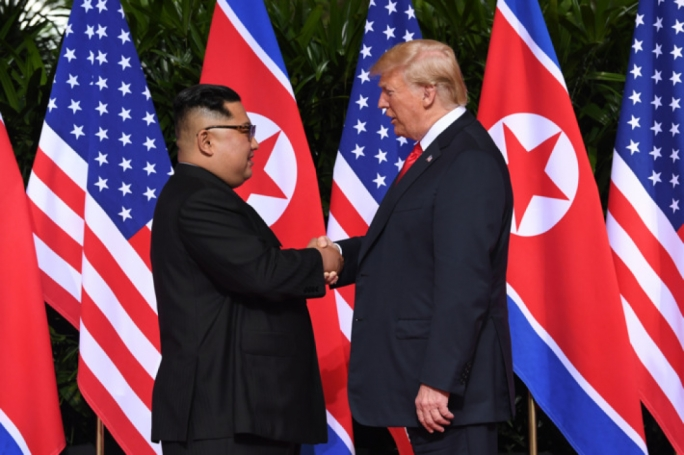 Trump and Kim Jong-un shaking hands during the Summit.