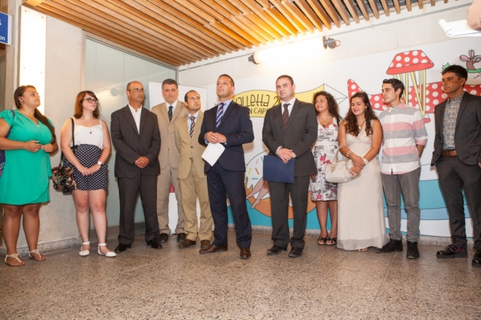 V-18 chairman Jason Micallef (centre) flanked by justice minister Owen Bonnici (right) and MCAST principal (fourth from left) Stephen Cachia, and other MCAST students