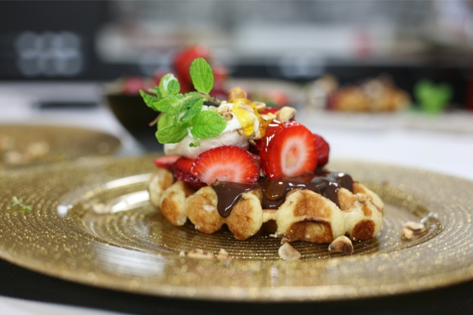 Belgian waffles with fresh strawberries and chocolate