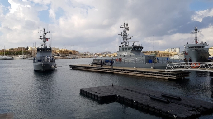Patrol boat docks in Malta on Saturday as migrants disembark before resettlement