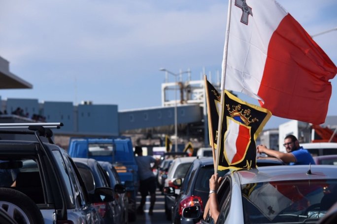 PN supporters wait for the ferry ahead of the mass meeting in Gozo. Photo: James Bianchi