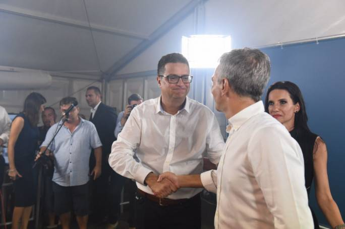 Simon Busuttil (right) congratulated Delia on his victory