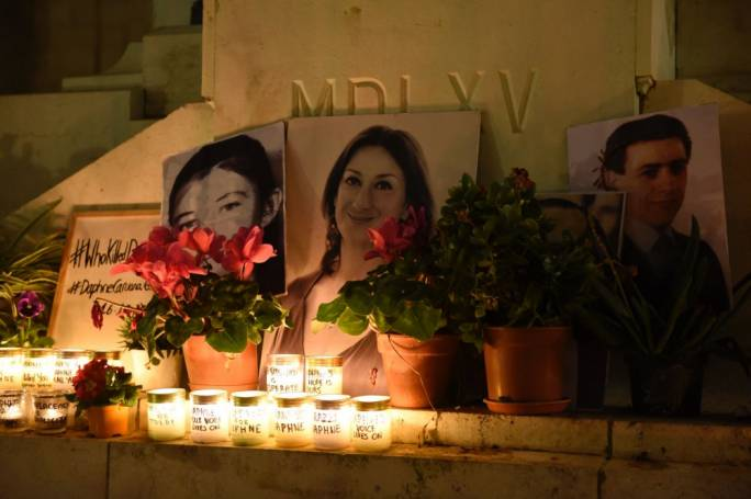 Victims of Malta's partisanship: the photo of Karen Grech, killed by a letter-bomb addressed to her father, and of Raymond Caruana (right), shot in an assault on a PN club, by the photo of Caruana Galizia