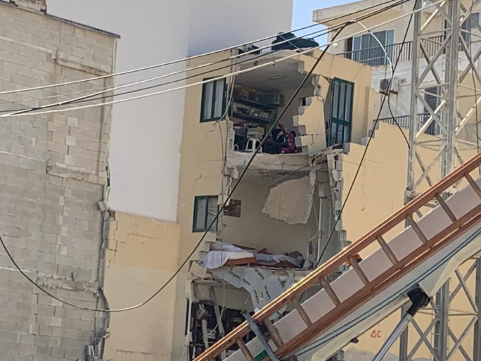 The elderly woman was reportedly trapped in one of the pictured rooms in the adjacent building (Photo: Karl Azzopardi/MediaToday)