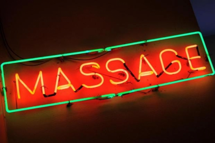 Seven charged over prostitution in massage parlours