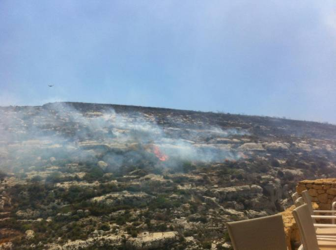 Flames spread slowly in Tal-Katra Valley in Gozo