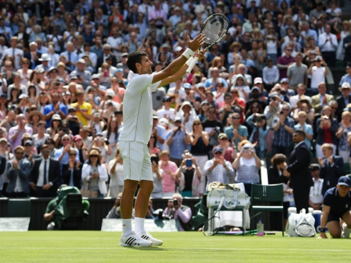 Novak Djokovic applauds the Centre Court crowd after his victory