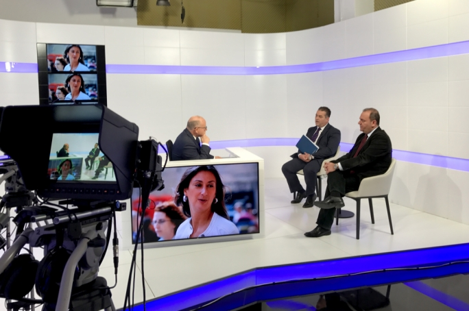 Chris Cardona (right) said he would present evidence of his whereabouts in a court of law. Also pictured are Beppe Fenech Adami (left) and inset, Daphne Caruana Galizia.
